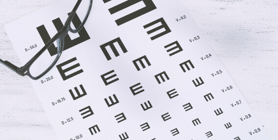 eye exam sheet with pair of glasses